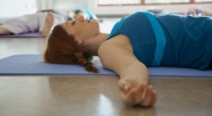 14 Apr 2012 --- Young woman relaxing in yoga class. --- Image by © Hero Images/Corbis
